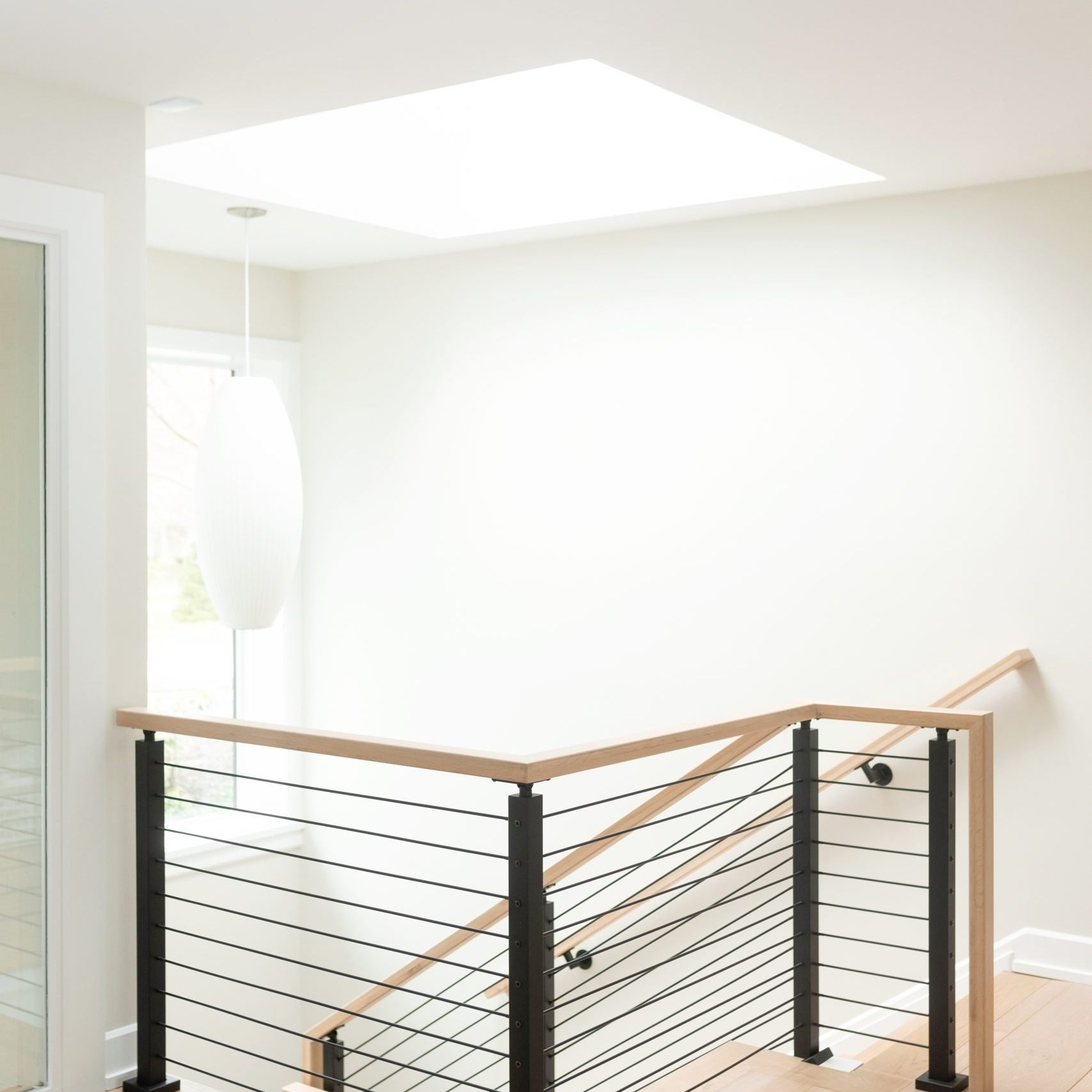 Modern Staircase with cable railing, modern metal stair, Kenowa Builders, Grand Rapids remodeling
