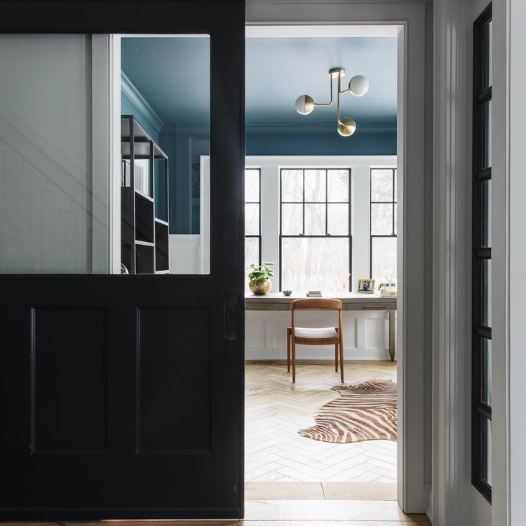 Kenowa Builders barn door with home office, with Jean Stoffer Design