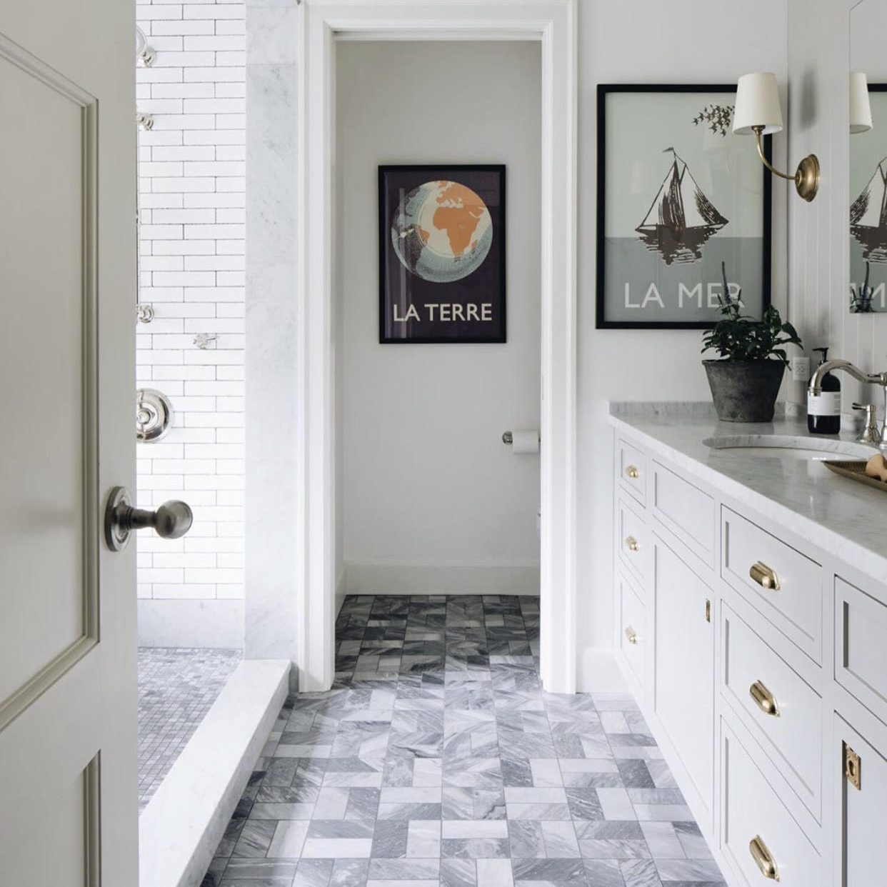 Modern Farmhouse Bathroom by Kenowa Builders vanity, bathroom sconces, and bathroom cabinets