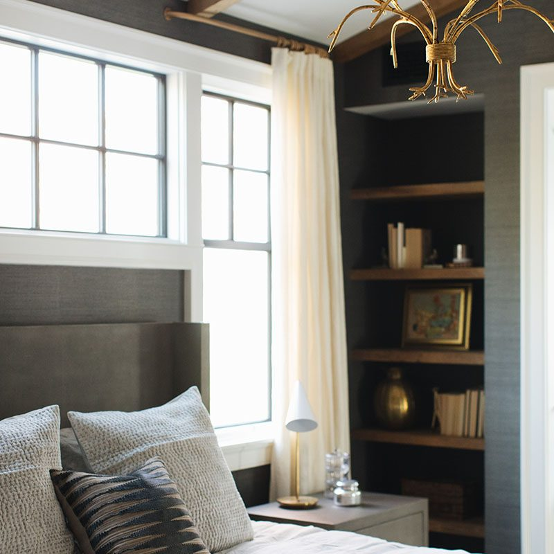 Kenowa Builders: Traditional Bedroom Design with Window Seat Built In Shelf Styling