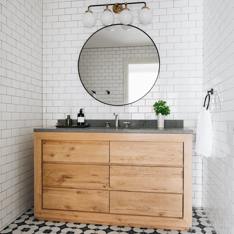 Kenowa Builders: Modern Neutral Bathroom design with subway tile, vanity, cement tile, Jean Stoffer design, Michigan home builder