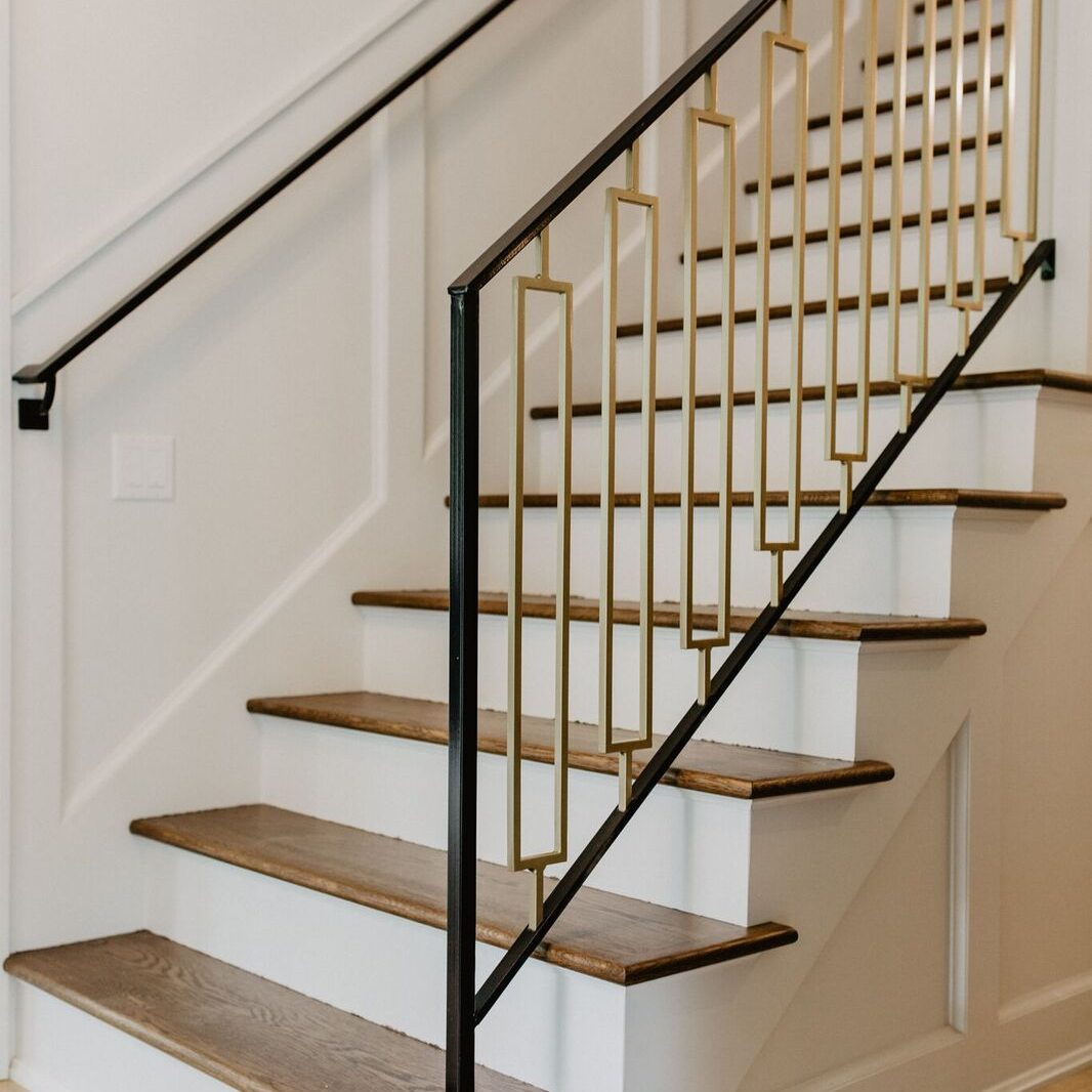 Kenowa Builders: Staircase with custom railing, Front Foyer Stairs Remodel