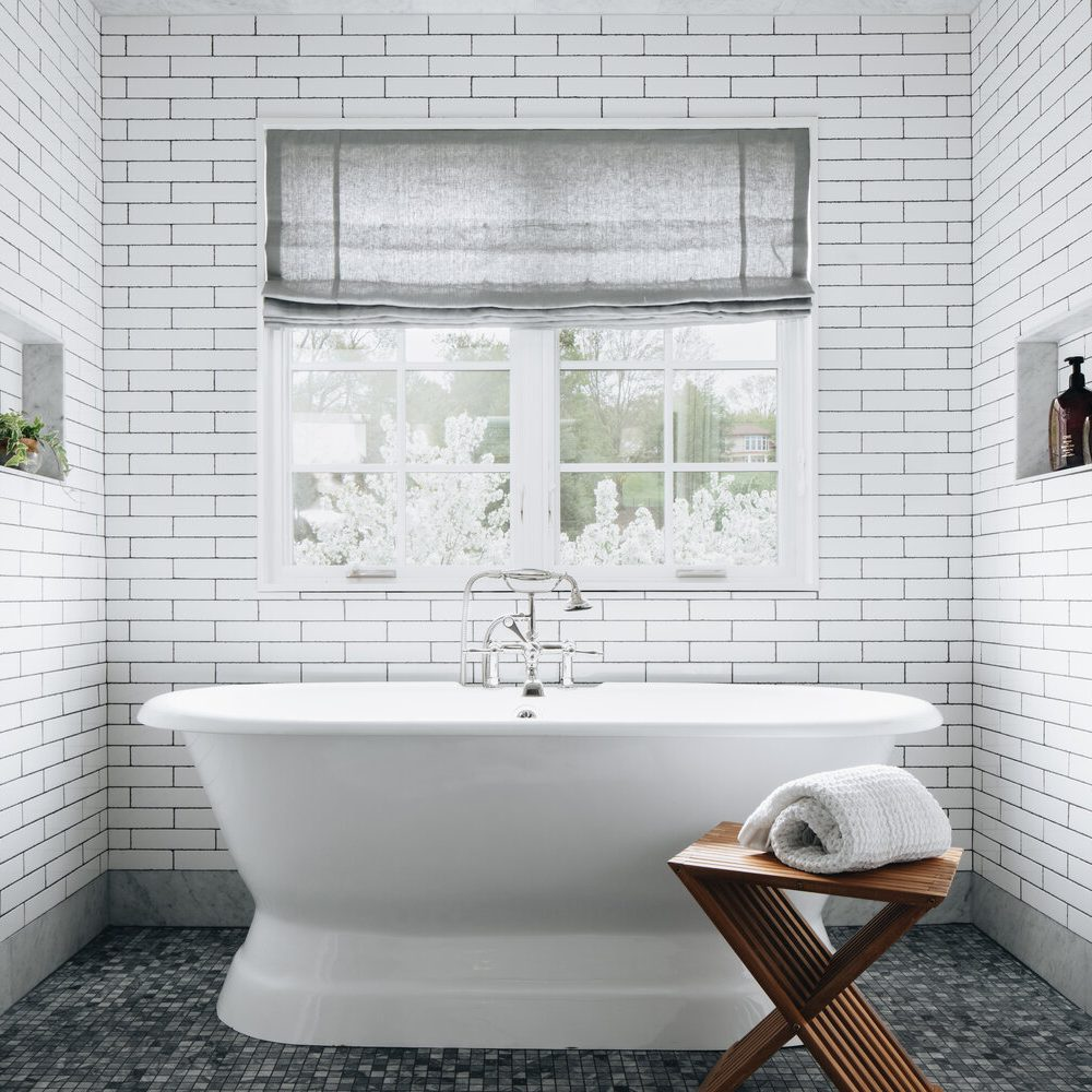 Kenowa Builders: Neutral Bathroom with bathtub and subway tile, White Bathroom Design, Jean Stoffer Design, Michigan home builder